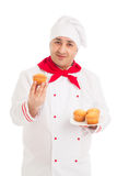 Chef holding plate with muffins wearing red and white uniform Royalty Free Stock Photography