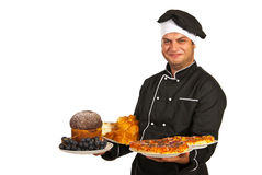 Chef holding plates with food Stock Image