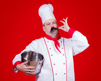 Chef holding a pot Royalty Free Stock Photos