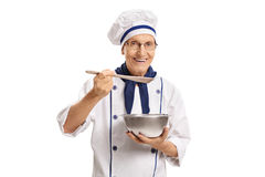 Chef holding a pot and a spoon. Isolated on white background Royalty Free Stock Photos