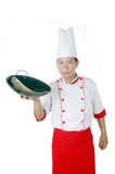 Chef holding raw fish on a black frying pan. Isolated on white background Royalty Free Stock Photo