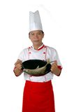 Chef holding raw fish on a frying pan. Chef holding raw fish on a black frying pan isolated on white background Royalty Free Stock Images