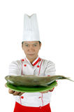 Chef holding raw fish on a green plate. Isolated on white background Stock Images