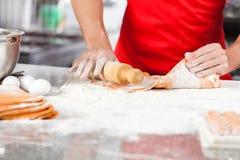 Chef Holding Rolling Pin While Preparing Ravioli Stock Photo