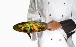 Chef holding salad. African or American chef presenting healthy food chicken salad Royalty Free Stock Photography