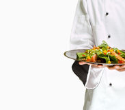 Chef holding salad. African or American chef presenting healthy food chicken salad Stock Image