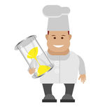 Chef holding sandglass Royalty Free Stock Photos