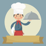 Chef holding silver cloche. Royalty Free Stock Photo