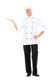 Chef holding something on his palm Royalty Free Stock Photo