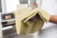 Chef Holding Spaghetti Pasta Sheet Stock Photos