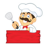 Chef Holding Spatula. Clipart Picture of a Chef Cartoon Character Holding Spatula Stock Image