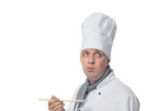 Chef holding a spoon and thinking Royalty Free Stock Photo