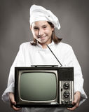 Chef  holding television Royalty Free Stock Photography