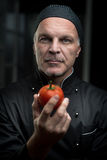 Chef holding a tomato Royalty Free Stock Photography