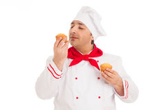 Chef holding two muffins wearing red and white uniform Royalty Free Stock Photo