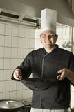Chef Holding a Wok Royalty Free Stock Photography