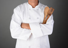Chef Holding Wood Utensils stock photography
