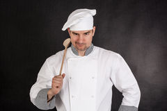 Chef holding wooden spoon Royalty Free Stock Image