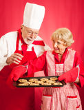 Chef and Housewife Baking Cookies Stock Image