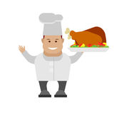 Chef holding a dish with baked bird Royalty Free Stock Photo