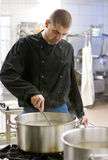 Chef in industrial kitchen royalty free stock photo