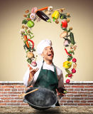 Chef juggling with vegetables Royalty Free Stock Photography