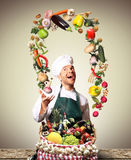 Chef juggling with vegetables Royalty Free Stock Photos