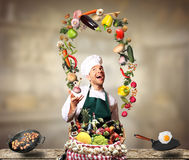 Chef juggling with vegetables Stock Photography