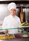 Chef with kebab at fastfood Stock Images