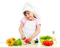 Chef kid girl preparing healthy food over white background Royalty Free Stock Photography