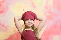Chef kid, happy girl cook in red chef hat, apron Stock Photography