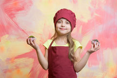 Chef kid, happy girl cook in red chef hat, apron Royalty Free Stock Photography