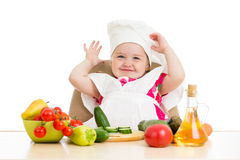 Chef kid preparing healthy food Stock Images