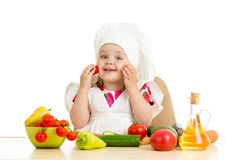 Chef kid preparing healthy food Stock Photography
