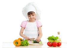 Chef kid preparing healthy food Stock Photos
