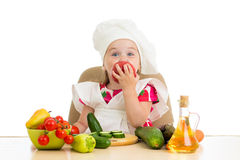 Chef kid preparing healthy food Stock Photos