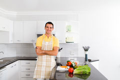 Chef in kitchen. Happy young chef posing in a modern kitchen Stock Photography