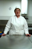 Chef in kitchen. A professional chef standing in her kitchen Stock Images