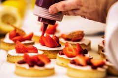 The chef in the kitchen prepares strawberry desser. T.Close up stock photos
