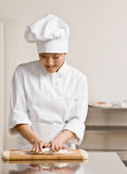 Chef  in kneading dough in commercial kitchen Royalty Free Stock Photo