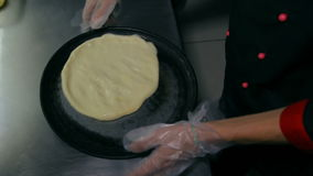 Chef kneading the dough in the pan stock video footage