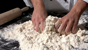 Chef kneading ingredients together to form a dough stock video