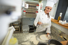 Chef kneading pizza dough Stock Photos