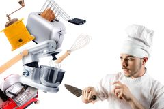 Chef with knife defending himself from kitchen utensils stock photography
