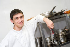 Chef with knife in kitchen Stock Photos