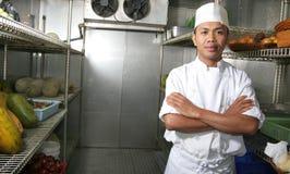 Chef-kok in de ijskast Stock Afbeelding