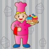 Chef-kok die een cupcake houden Stock Foto
