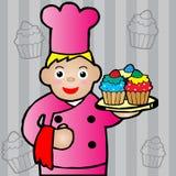 Chef-kok die een cupcake houden Royalty-vrije Stock Fotografie