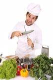 Chef-kok die een mes scherpt Royalty-vrije Stock Afbeelding