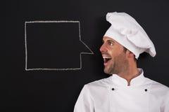 Chef-kok die iets zeggen Royalty-vrije Stock Afbeeldingen